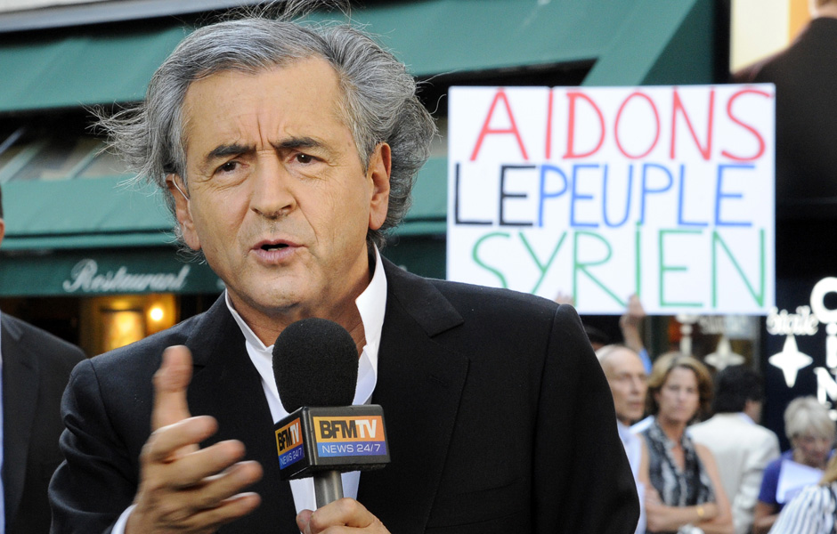 "The shameless fraudulent ""philosophe"" Bernard-Henri Lévy—a proud Zionist—in a photo op designed to promote further aggression against the Syrian government. He has made a career out of imperialist shilling like this, and is naturally warmly received by all the top gatekeepers in the Western machinery of propaganda."